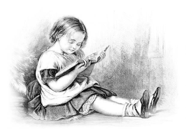 Petite fille lisant un livre d'images